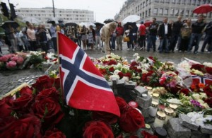 136310-a-norwegian-flag-sticks-out-of-a-bunch-of-red-roses-on-the-market-squa